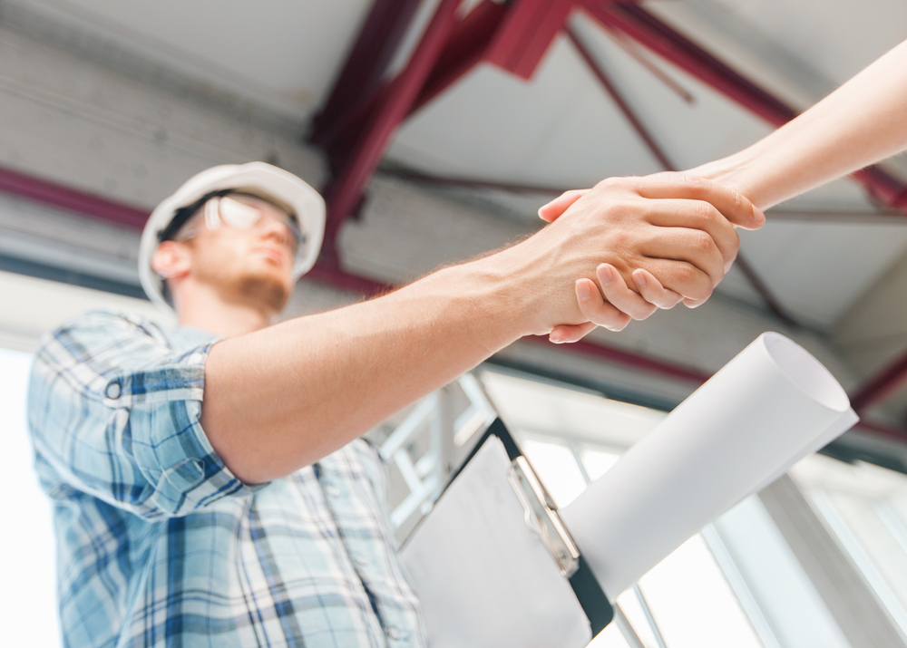 An Iowa Contractor shakes hands with a client