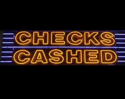 A 'Checks Cashed' sign