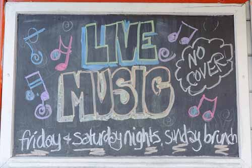 A chalkboard with 'Live Music' written in chalk