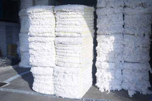 Cotton is piled up at a warehouse