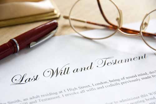 A Last Will and Testament lays on a table. A judge may require an Administrator or Executor be bonded before handling a deceased person's estate.