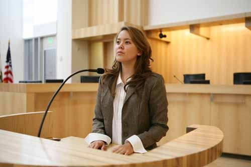 A woman testifies in court