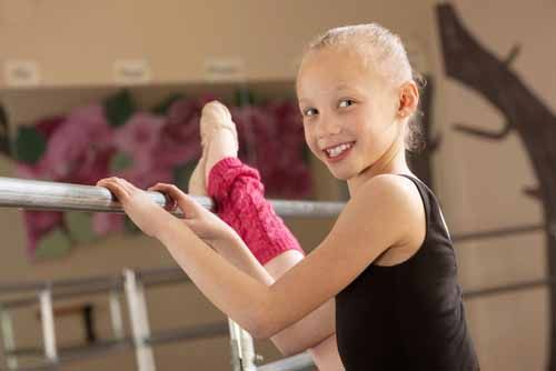 A girl stretches at a Florida Dance Studio