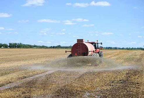 A Florida Fertilizer truck sprays a field.