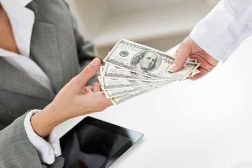 A client hands money to an investment adviser