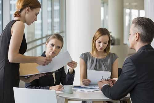 A Georgia Insurance Counselor Meets With Clients