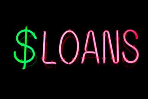A neon sign that says 'Loans'