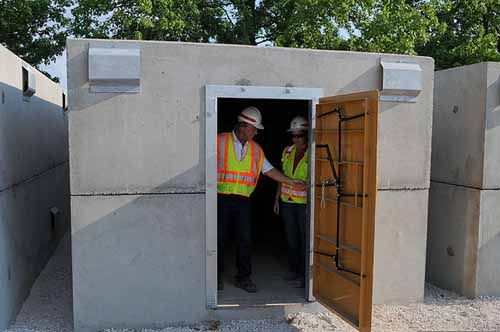 A storm shelter is being inspected