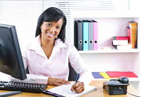 A title agent sits at her desk