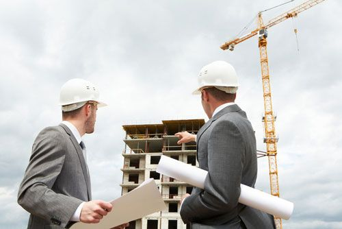 Contractors check the progress of a construction project