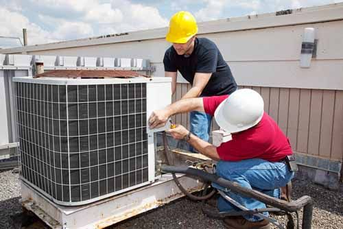 Mechanical contractors work on an HVAC system