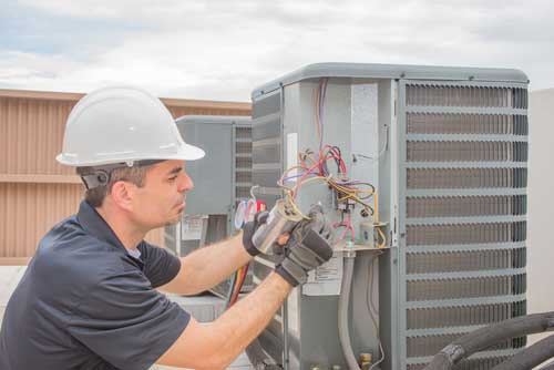 A contractor works on an hvac system