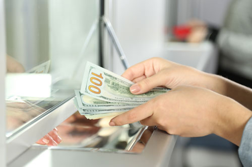 A client hands money to a money transmitter