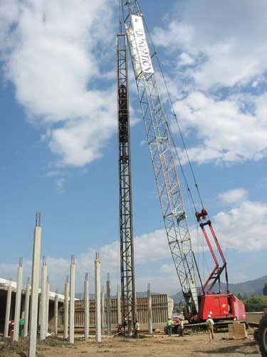 A pile driver contractor works on a project