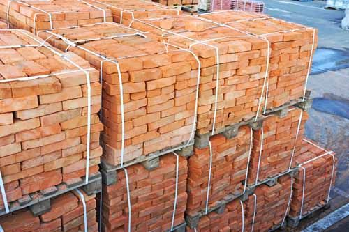 Bricks are stacked up, ready to be used in a project