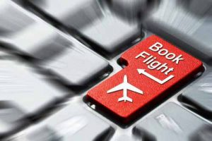 "A keyboard with a key ""Book Flight"" highlighted"