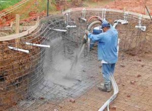A construction worker installs a pool.
